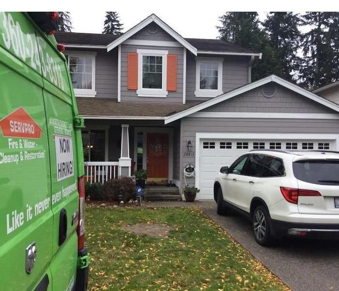 SERVPRO vehicle sitting in front of a home.