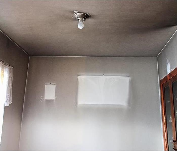 smoke damage on wall and ceiling