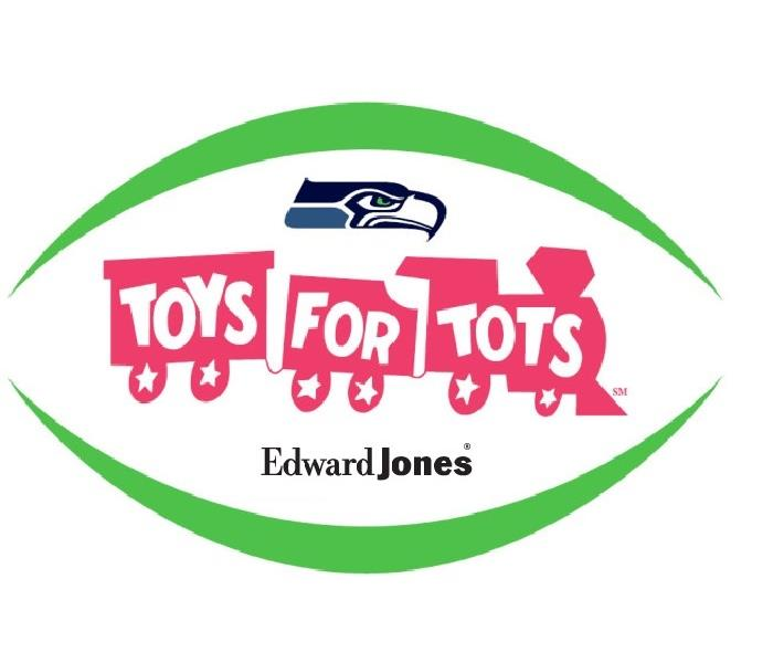 Community Help out Edward Jones, Seattle Seahawks, and the U.S. Marines collect toys for Toys for Tots!