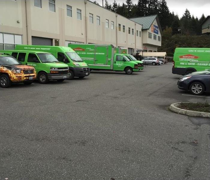 SERVPRO vehicles parked outside of building