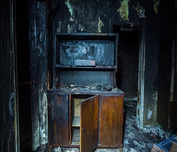 Interior of burned house with burned furniture.