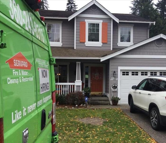 SERVPRO vehicle parked on the road in front of a home.