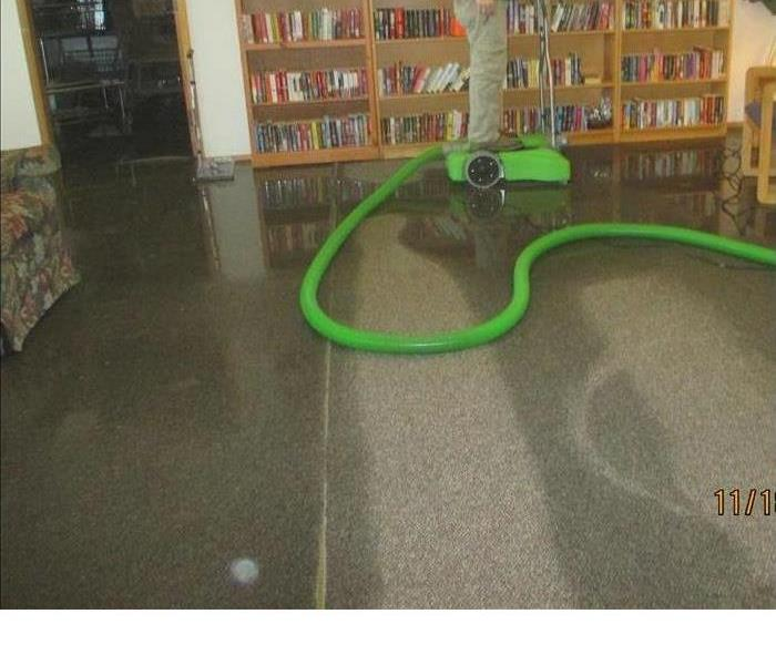 A water extraction equipment removing water from the floor